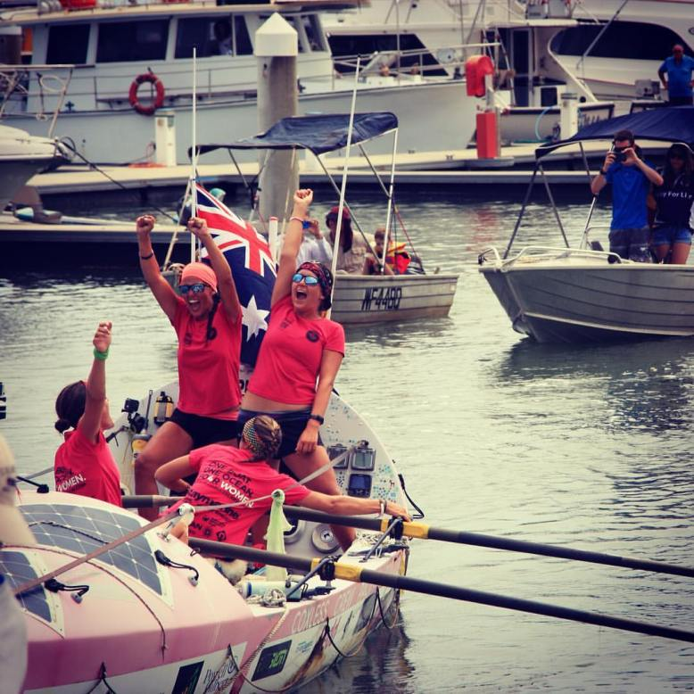 The Coxless Crew pulling in to the harbour at Cairns