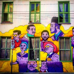 Colourful faces cover every wall